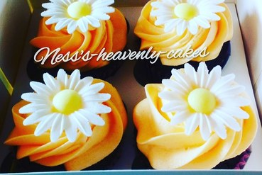 choc orange cupcakes topped with wafer daisies