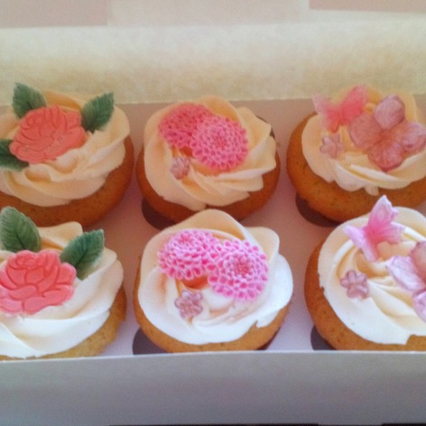 Floral and butterfly medley, any occasion cupcakes.