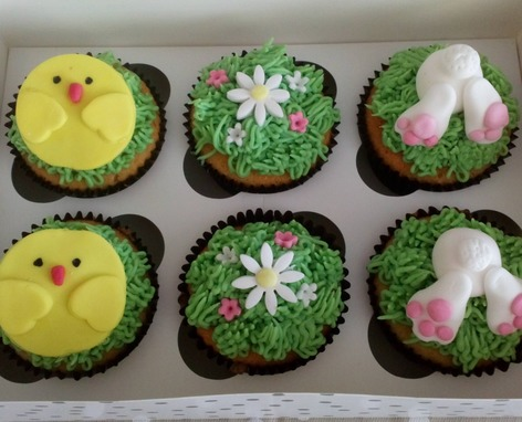 Box of Easter chicks and bunnies cupcakes